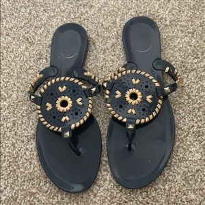 Jack Rogers jelly sandals.
